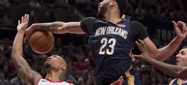Anthony Davis of the New Orleans Pelicans blocks Damian Lillard of the Portland Trail Blazers.