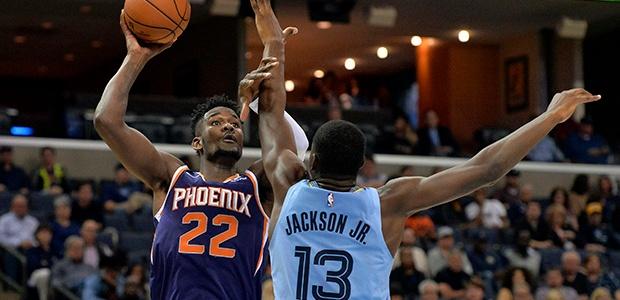 DeAndre Ayton of the Phoenix Suns shoots against Jaren Jackson Jr of the Memphis Grizzlies.