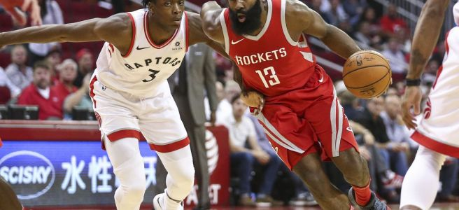 James Harden of the Houston Rockets drives past OG Anunoby of the Toronto Raptors